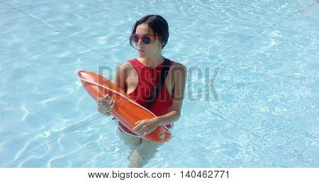 Lifeguard walking through shallow water