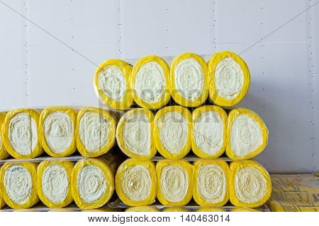 Package of thermal insulation material rock wool is wrapped in foil.