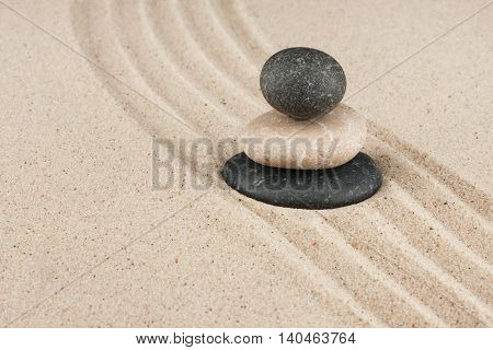 Pyramid made of stones standing on the sand with space for your text