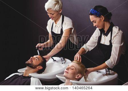 Customers getting their hair wash at a salon