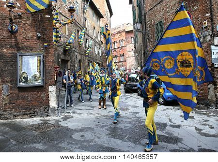 SIENA ITALY JUNE 12 2016 : drums and flags parade Siena piazza del campo june 12 2016 in Siena Italy