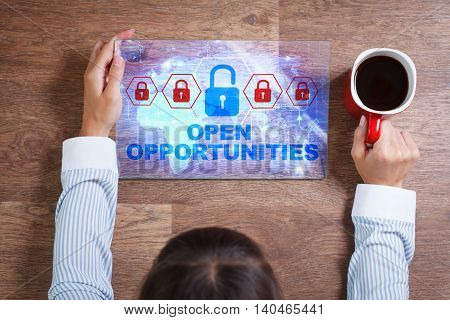 Business Technology Internet and network concept. Young business woman with a cup of coffee working on the tablet of the future select on the virtual display: Open opportunities