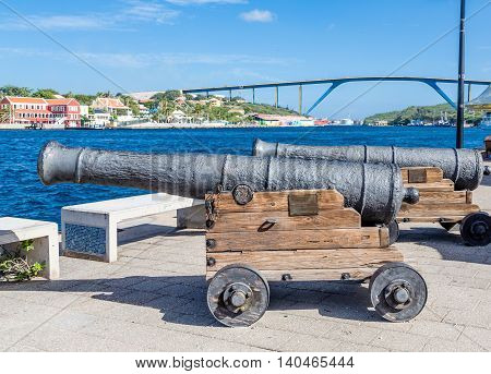 Two Old cannons on walkway in Curacao