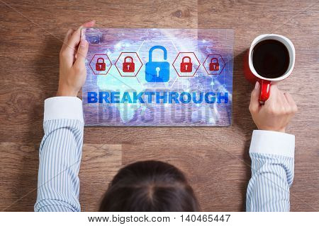 Business Technology Internet and network concept. Young business woman with a cup of coffee working on the tablet of the future select on the virtual display: Breakthrough