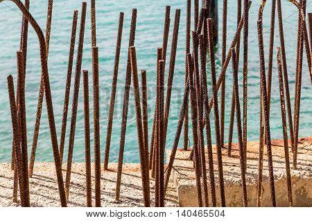 Rusty Rebar in concrete by the sea