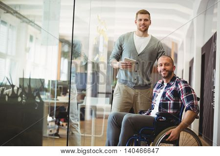 Portrait of handicap businessman with colleague in creative office