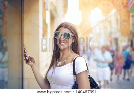 Happy woman in fashionable clothes