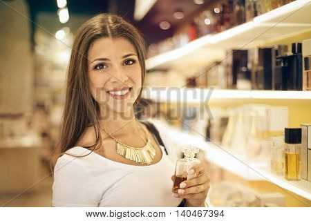 Smiling woman in a perfumery