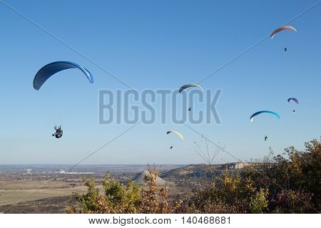 Paraglider flying in the sky over the