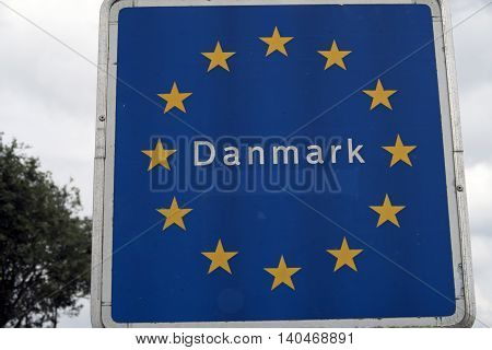 Blue border sign of Denmark with yellow stars closeup.
