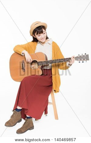 Young Musician Holding A Guitar