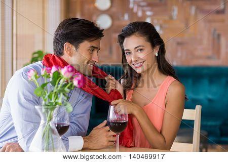 Romantic couple having fun together in restaurant