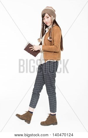 Girl Holding Textbooks