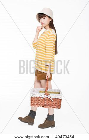 Girl Carrying A Basket In The Room