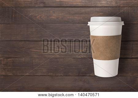 Top view coffee cup on the wooden background. Copyspace for your text.