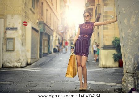 Fashionable woman posing in a street