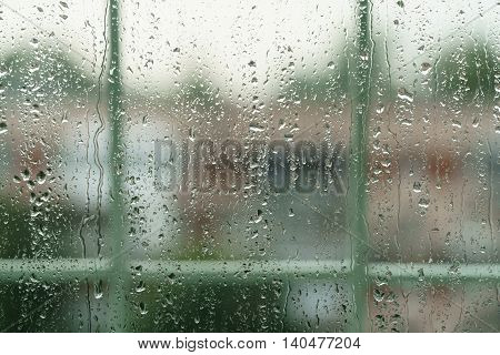 real rain drops on window glass in high resolution, backdrop