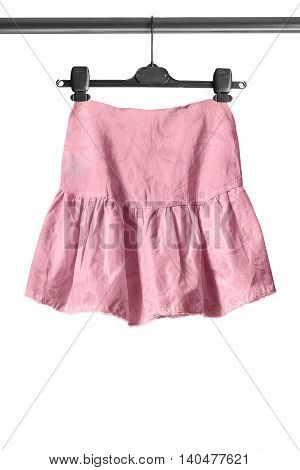 Pink flared skirt on clothes rack isolated over white