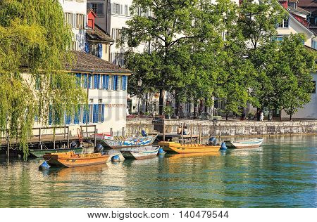 Zurich Switzerland - 30 July 2016: boats on the Limmat river in the historic Schipfe quarter. Zurich is the largest city in Switzerland and the capital of the Swiss canton of Zurich.