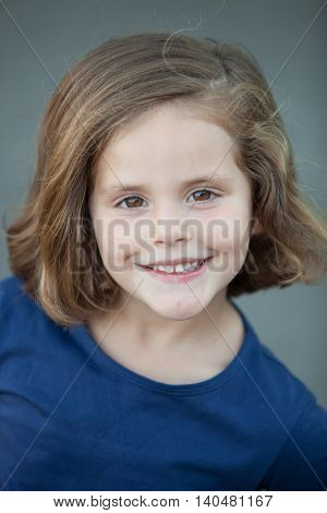 Cute little girl in a summer day smiling at camera