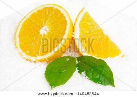 Orange Fruit And Leaves On Ice On White