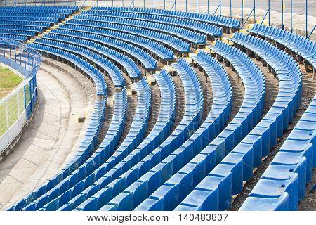 empty blue seats on the stadium corner