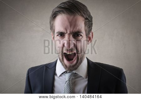 Young businessman screaming