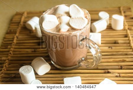 Mug filled with hot chocolate and marshmallow and candy