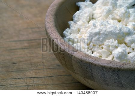 Cottage Cheese In Bowl On Wooden Table