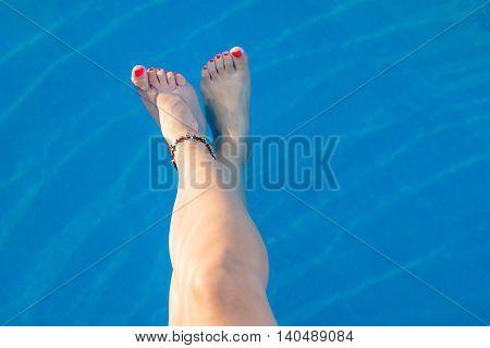 Woman Legs While Enjoying At The Pool