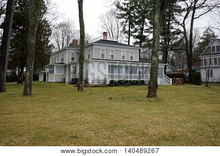 WEQUETONSING, MICHIGAN / UNITED STATES - DECEMBER 22, 2015: A large home on Beach Drive in Wequetonsing, Michigan.