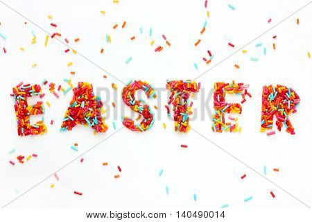 Easter holiday sugar sprinkling background top view