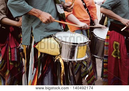 drummers play traditional music at a festival