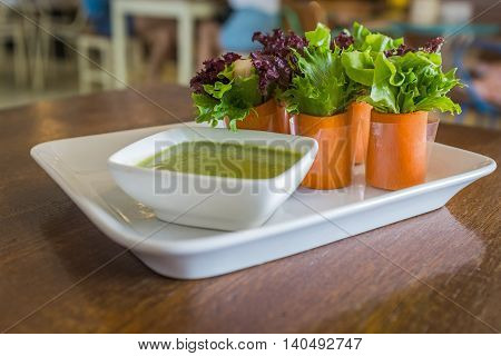 Caesar salad on rustic wooden table,focus on vegetable