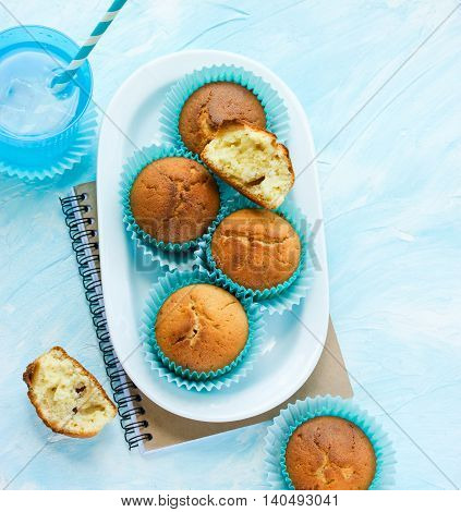 Muffins homemade for dessert with drink on a blue background top view blank space for text