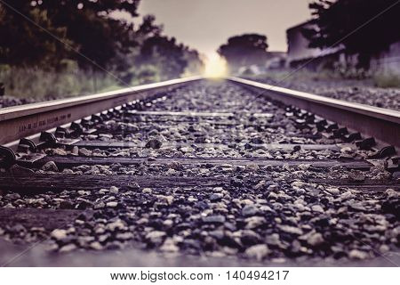 Railroad Photo, A railroad with a sun at the end