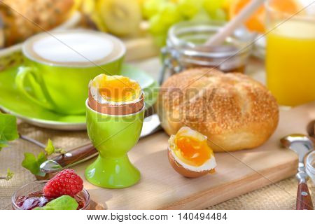 Outside served breakfast with a soft boiled egg and fresh rolls
