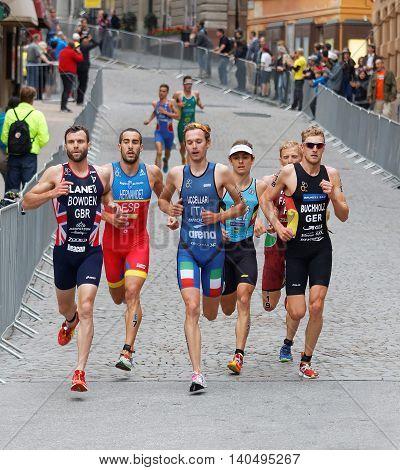 STOCKHOLM - JUL 02 2016: Running triathletes in the old town of Stockholm in the Men's ITU World Triathlon series event July 02 2016 in Stockholm Sweden
