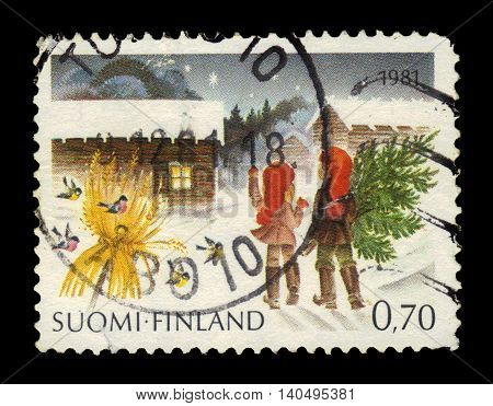 FINLAND - CIRCA 1981: a stamp printed in Finland shows children carry a christmas tree to their home, series christmas, circa 1981