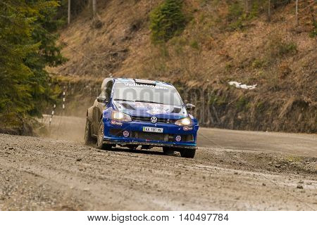 Lviv Ukraine - March 13 2016: Unknown racer on the car brand Volkswagen Polo Concept (No.5) overcome the track at the annual Rally of Winter peaks near the city of Nyzni Worota Ukraine
