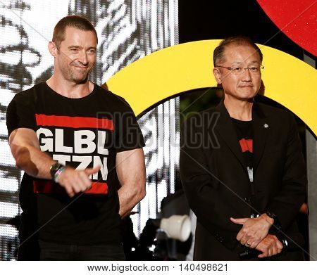 NEW YORK-SEPT 27: Actor Hugh Jackman (L) & President of the World Bank, Jim Yong Kim at the 2014 Global Citizen Festival to end poverty by 2030 in Central Park on September 27, 2014 in New York City.