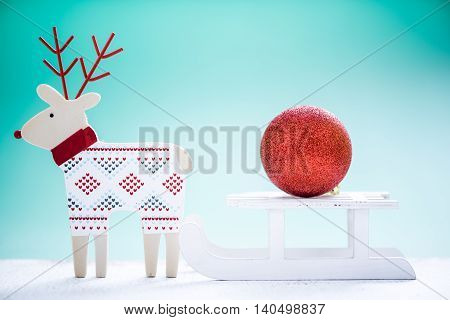 Reindeer And Snow Sled With Christmas Ball