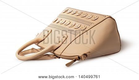 Elegant leather beige handbag lying isolated on white background