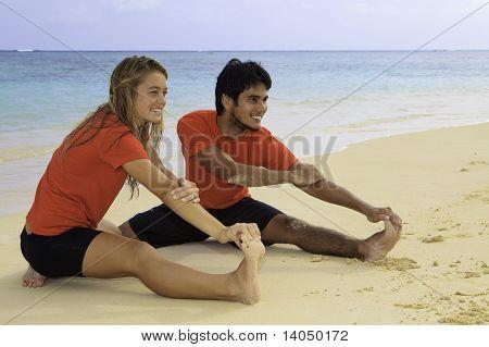 young couple doing yoga