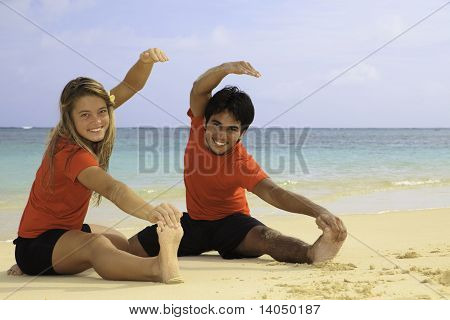 young couple doing yoga