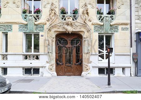 PARIS, FRANCE - MAY 12, 2015: This is entrance of an apartment house Lavirotte built in the Art Nouveau style.