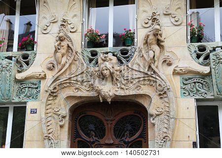 PARIS, FRANCE - MAY 12, 2015: This is a fragment of entrance of an apartment house Lavirotte built in the Art Nouveau style.