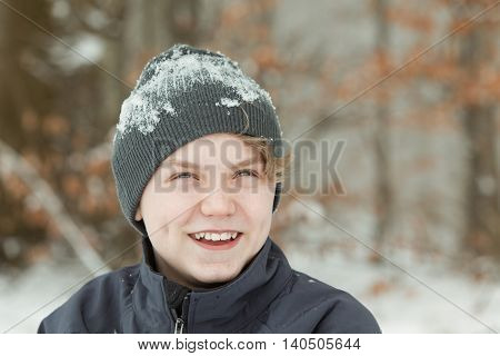 Smiling Teenage Boy Wearing Snow Covered Hat