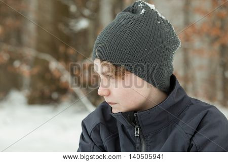 Serious Teen Boy In Gray Hat Outdoors In Winter
