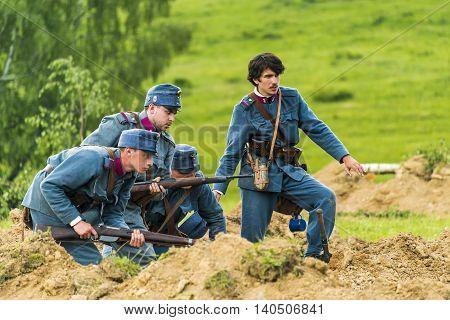 Snina Slovakia - May 28 2016: Military historical reconstruction battles of World War I Karpaty 1914/1916. Participants of the event stand on the attack near Snina Slovakia.